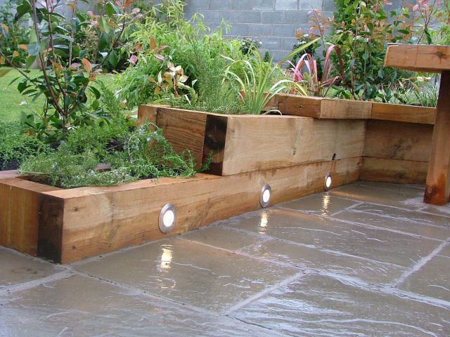 Wood shop raised garden bed ideas for Garden designs with raised beds